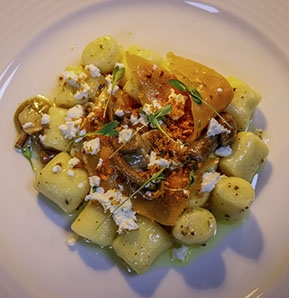 Photography recipe Yucca gnocchi fried in truffle butter, mixed mushrooms, squash and fresh goats cheese